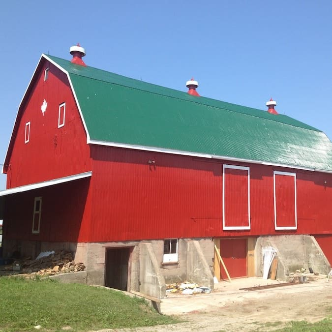 red nice barn fresh paint green roof